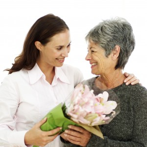 portrait of a mother and daughter holding a bouquet of flowers